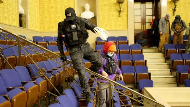 PHOTO: Protesters carring zip ties enter the Senate Chamber on in the Capitol in Washington, Jan. 6, 2021. (Win McNamee/Getty Images)
