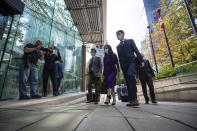 Meng Wanzhou, second from right, chief financial officer of Huawei, returns to B.C. Supreme Court after a break in her extradition hearing, Wednesday, Aug. 18, 2021, in Vancouver, British Columbia. (Darryl Dyck/The Canadian Press via AP)