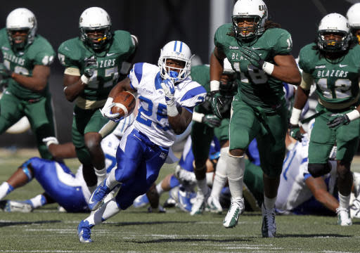 Middle Tennessee State running back Reggie Whatley breaks free for a long run during the second half of an NCAA college football game against UAB on Saturday, Nov. 2, 2013, in Birmingham, Ala. (AP Photo/Butch Dill)