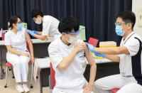 Medical workers receive doses of the vaccine against the coronavirus disease (COVID-19) at the Tokyo Metropolitan Cancer and Infectious Diseases Center Komagome Hospital in Tokyo