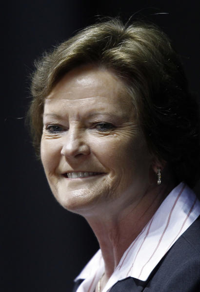 """FILE - In this April 19, 2012 file photo, former Tennessee women's college basketball coach Pat Summitt smiles as she appears at a news conference in Knoxville, Tenn., where she announced she is stepping aside after 38 seasons. Summitt has an agreement with Crown Archetype, an imprint of Random House Inc., for a memoir that is currently untitled. According to Crown, which announced the deal Tuesday, April 24, the book will cover her """"full life journey,"""" including her diagnosis last year of early-onset dementia, Alzheimer's type. Publication is expected in spring 2013. (AP Photo/Wade Payne, file)"""