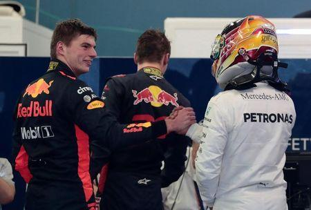Formula One - F1 - Australian Grand Prix - Melbourne, Australia - 25/03/2017 Red Bull Racing driver Max Verstappen of the Netherlands (L) congratulates Mercedes driver Lewis Hamilton of Britain after the qualifying session. REUTERS/Jason Reed