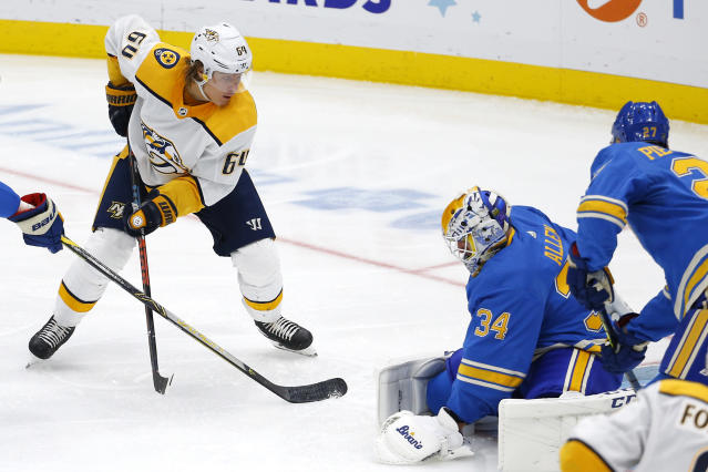 Nashville Predators' Mikael Granlund, top left, of Finland, watches his shot get past St. Louis Blues goaltender Jake Allen for the game winning goal during the third period of an NHL hockey game Saturday, Feb. 15, 2020, in St. Louis. (AP Photo/Billy Hurst)
