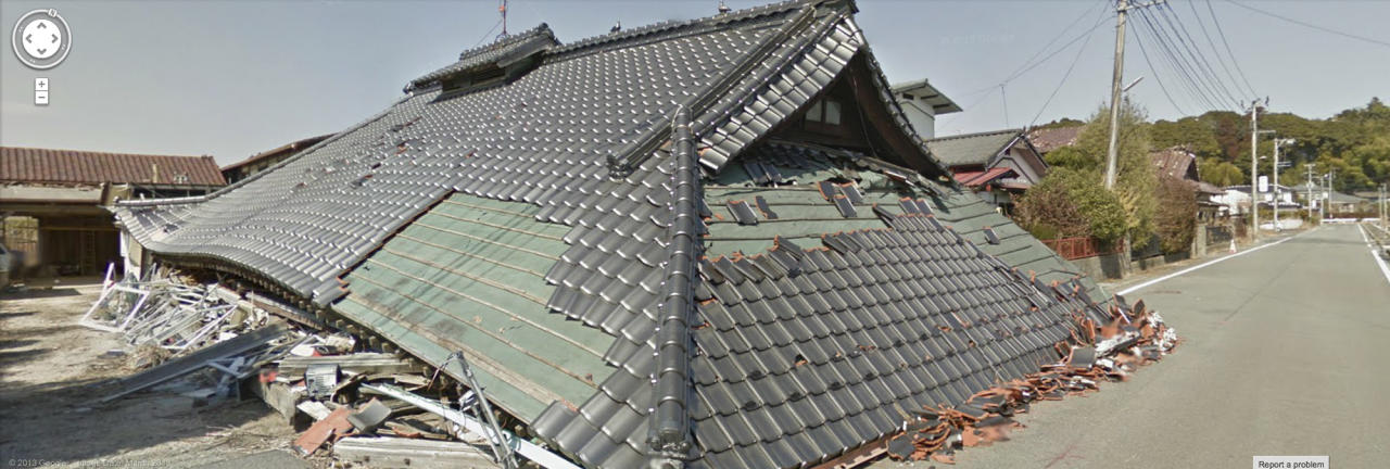 In this screenshot made from the Google Maps website provided Wednesday, March 27, 2013, by Google, showing a crushed building with the roof atop in March 2013, in Namie, Japan, a nuclear no-go zone where former residents have been unable to live since they fled from radioactive contamination from the Fukushima Dai-ichi nuclear power plant two years ago. Google Street View is giving the world a rare glimpse into Japan's eerie ghost town, following the March 2011 earthquake and tsunami which sparked a nuclear disaster that has left the area uninhabitable. The photo technology pieces together digital images captured by Google's camera-equipped vehicle and allows viewers to take virtual tours of locations around the world, including faraway spots like the South Pole and fantastic landscapes like the Grand Canyon, or in this case contaminated deserted townscapes. (AP Photo/Google) EDITORIAL USE ONLY