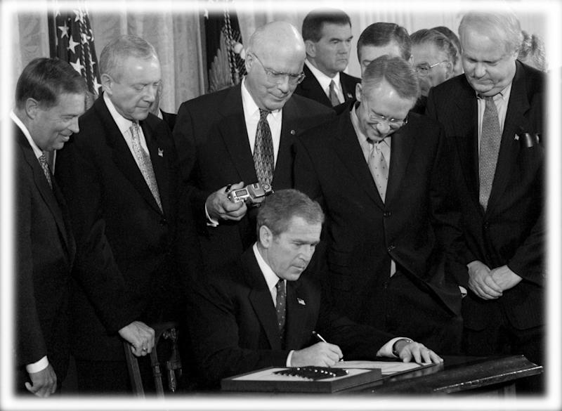 President George W. Bush signs the Patriot Act Anti-Terrorism Bill into law during a ceremony at the White House, October 26, 2001. (Photo: Kevin Lamarque/Reuters; digitally enhanced by Yahoo News)