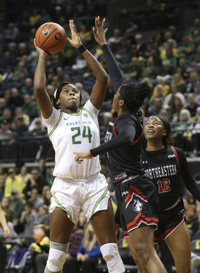 Oregon's Ruthy Hebard, left, shoots over Northeastern's Alexis Hill, center, and Ayanna Dublin during the second quarter of an NCAA college basketball game in Eugene, Ore., Monday, Nov. 11, 2019. (AP Photo/Chris Pietsch)