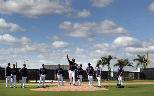 Houston Astros pitcher Rogelio Armenteros works on his pickoff move to first as teammates watch during spring training baseball practice Thursday, Feb. 15, 2018, in West Palm Beach, Fla. (AP Photo/Jeff Roberson)
