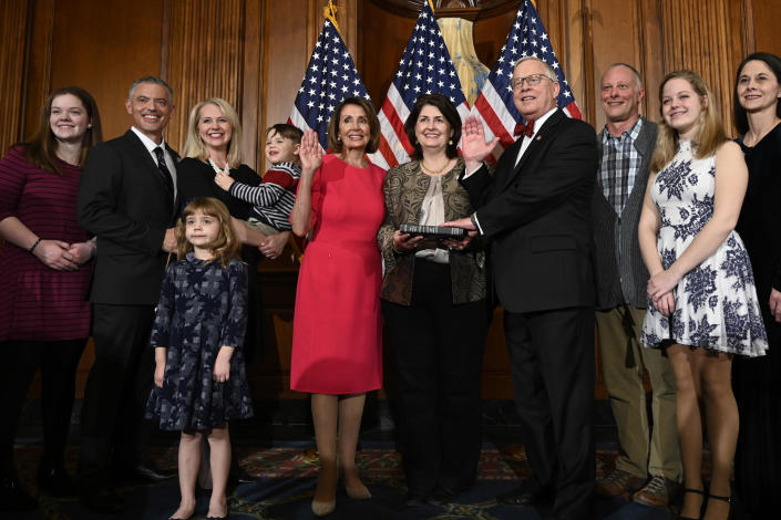 In this January 3, 2019 file photo, House Speaker Nancy Pelosi of Calif., poses during a ceremonial swearing-in with Rep. Ron Wright, R-Texas, fourth from right, on Capitol Hill in Washington during the opening session of the 116th Congress. / Credit: Susan Walsh / AP
