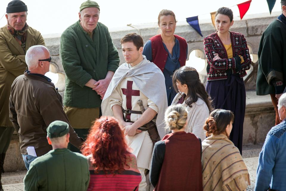 """Welsh actor Taron Egerton as """"Robin Hood"""" (C-L) and Irish actress Eve Hewson as """"Maid Marian"""" (C-R) play during the film shooting of """"Robin Hood: Origins"""" in Dubrovnik, Croatia, on February 20, 2017. After hosting """"Star Wars"""" and """"Game of Thrones"""", Croatia's Adriatic resort of Dubrovnik was transformed into medieval Nottingham on Monday for a Leonardo DiCaprio-produced adaptation of Robin Hood. With a budget of between $70 and 100 million (66-94 million euros), according to local media, """"Robin Hood: Origins"""" is set to be the most expensive movie ever filmed in the country. / AFP / -        (Photo credit should read -/AFP/Getty Images)"""