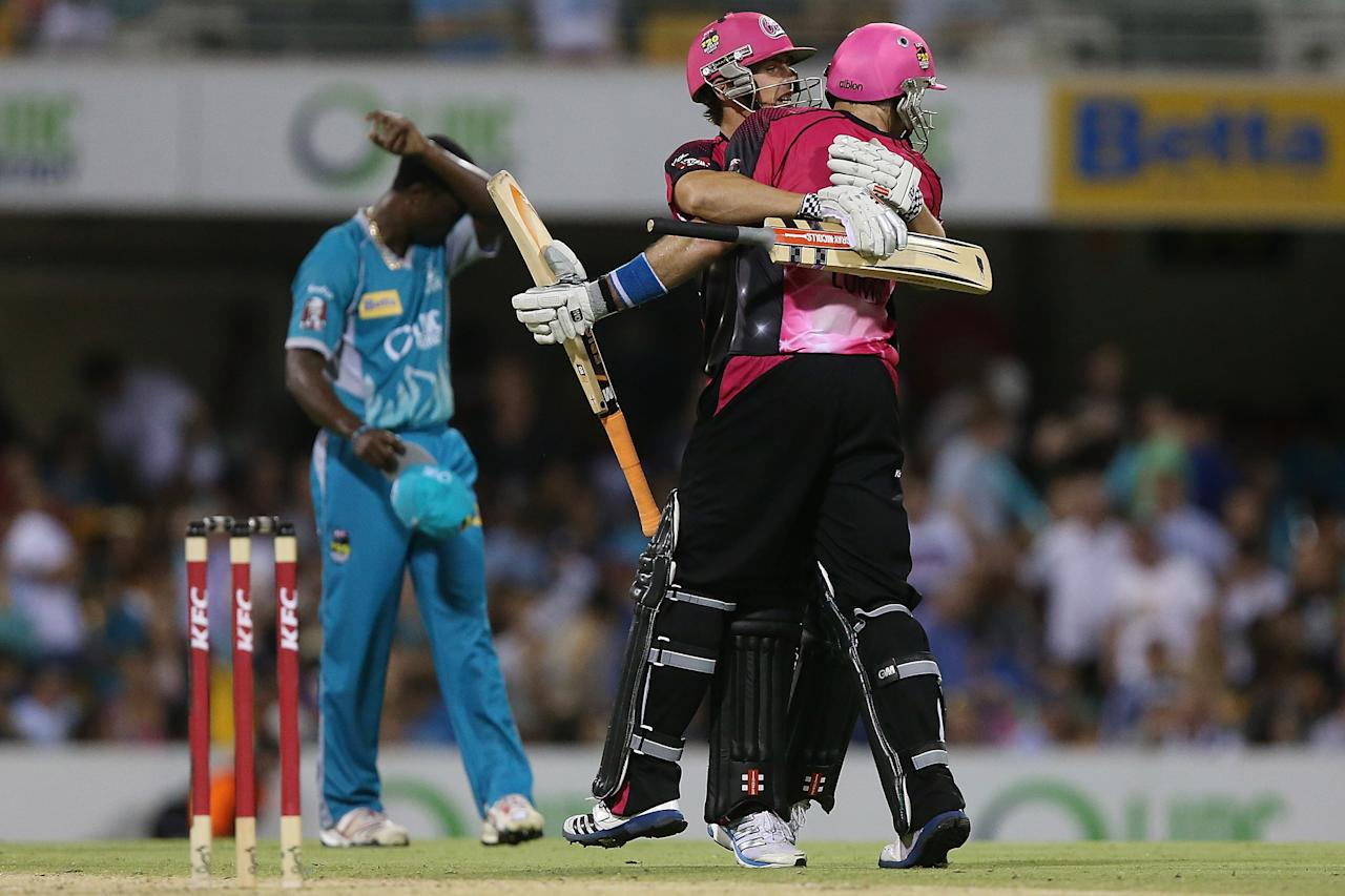 BRISBANE, AUSTRALIA - JANUARY 07:  Stephen O'Keefe and Michael Lumb of the Sixers celebrate winning the Big Bash League match between the Brisbane Heat and the Sydney Sixers at The Gabba on January 7, 2013 in Brisbane, Australia.  (Photo by Chris Hyde/Getty Images)