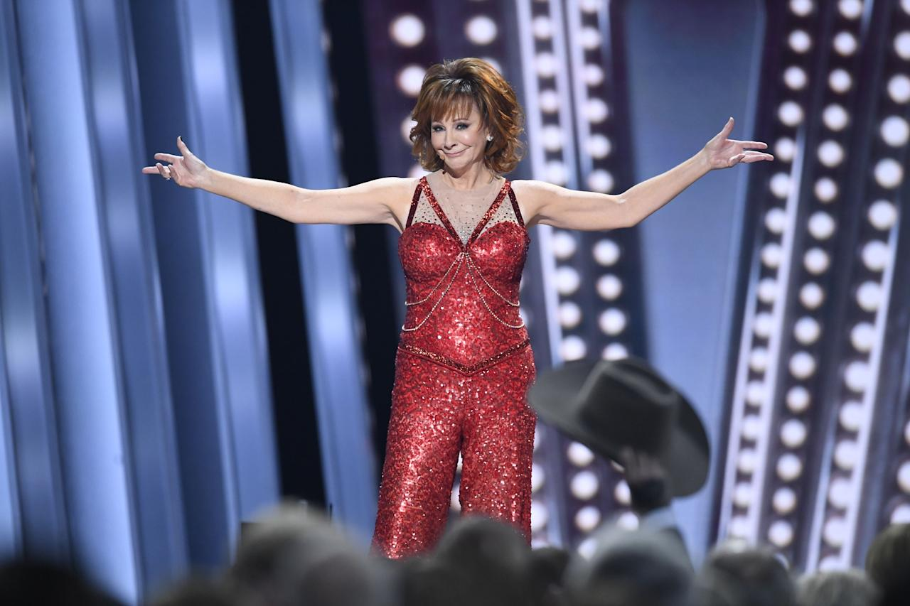 "<p>If you're a fan of country music and addictively good sitcoms, you probably have a special place in your heart for redhead wonder <a href=""https://www.countryliving.com/life/entertainment/g19695602/reba-mcentire-acm-awards/"">Reba McEntire.</a> The 64-year-old singer is widely revered as <a href=""https://www.countryliving.com/life/entertainment/a29799445/reba-mcentire-fancy-performance-cma-awards-2019/"">the queen of country music</a>, though she's had her fair share of silver screen debuts, too. She starred as Reba Hart in <a href=""https://www.countryliving.com/life/entertainment/a19458360/reba-mcentire-reba-reboot/"">the early 2000s sitcom </a><em><a href=""https://www.countryliving.com/life/entertainment/a19458360/reba-mcentire-reba-reboot/"">Reba</a>, </em>and, more recently, as<a href=""https://www.countryliving.com/life/entertainment/a30631391/reba-mcentire-guest-star-young-sheldon/""> June in the smash-sitcom <em>Young Sheldon.</em></a></p><p>And to think, it all started in 1974 when she sang ""The Star-Spangled Banner"" at the National Finals Rodeo in Oklahoma City. There, she amazed attendees, one of whom was songwriter <a href=""https://www.imdb.com/name/nm0824134?ref_=nmbio_mbio"" target=""_blank"">Red Steagall</a>. After hearing her sing, Red suggested she pursue a career in country music and the rest was history. </p><p>Since then, Reba has won 16 Academy of Country Music Awards and been nominated for a total of 47. Additionally, she's won 14 American Music Awards, three Billboard Music Awards, two Blockbuster Entertainment Awards, and three Grammys (and that's not even all). As such, we're taking the time to give <a href=""https://www.countryliving.com/life/entertainment/a27010439/reba-mcentire-fancy-meaning-lyrics/"">the ""Fancy"" singer</a> our full attention and invite you to do the same. Ahead you'll find 21 photos from Reba's past, which, together, only make us even more excited for her future.</p>"