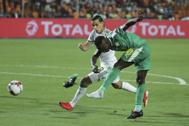 Senegal's Sadio Mane, right, looses a shoe during the African Cup of Nations final soccer match between Algeria and Senegal in Cairo International stadium in Cairo, Egypt, Friday, July 19, 2019. (AP Photo/Hassan Ammar)
