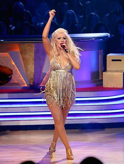 "At the ""DWTS"" finale show, Christina Aguilera performed two songs, including a raunchy rendition of ""Show Me How You Burlesque"" from her new film, ""Burlesque,"" which hit screens November 24, and also her Grammy Award-winning single, ""Beautiful."" ABC/ADAM LARKEY"