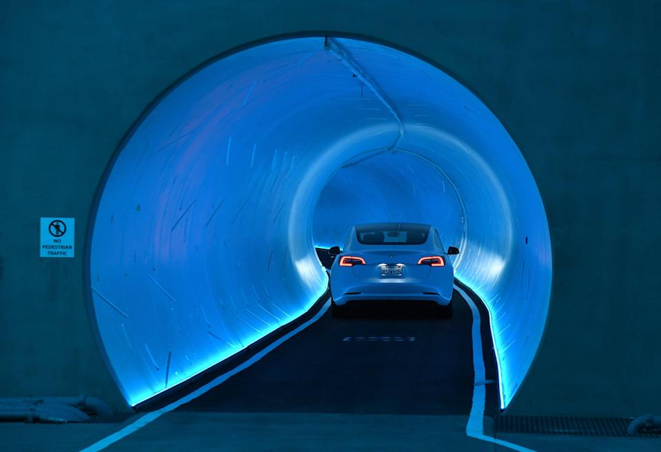 <p>A Tesla car drives through a tunnel in the Central Station during a media preview of the Las Vegas Convention Center Loop on April 9, 2021 in Las Vegas, Nevada. </p> ((Photo by Ethan Miller/Getty Images)