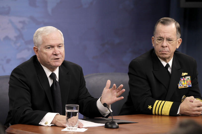 Defense Secretary Robert Gates and Joint Chiefs Chairman Adm. Mike Mullen, speaks to reporters on gays in the military, Tuesday, Nov. 30, 2010, at the Pentagon. (AP Photo/Charles Dharapak)