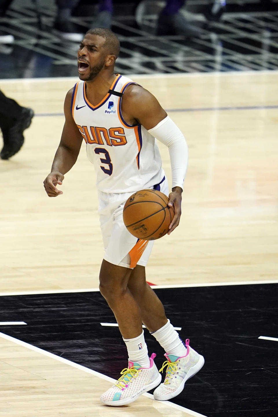 Phoenix Suns guard Chris Paul yells out instructions as he dribbles during the first half of an NBA basketball game against the Los Angeles Clippers Thursday, April 8, 2021, in Los Angeles. (AP Photo/Marcio Jose Sanchez)