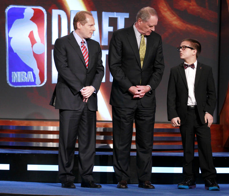 David Kahn, left, general manager of the Minnesota Timberwolves, Kevin O'Connor, center, general manager of the Utah Jazz, and Nick Gilbert, 14, right, the son of Cleveland Cavaliers owner Dan Gilbert, stand on the stage representing the final three teams during the 2011 NBA basketball draft lottery, Tuesday, May 17, 2011 in Secaucus, N.J. The Cavaliers won the lottery. (AP Photo/Julio Cortez)