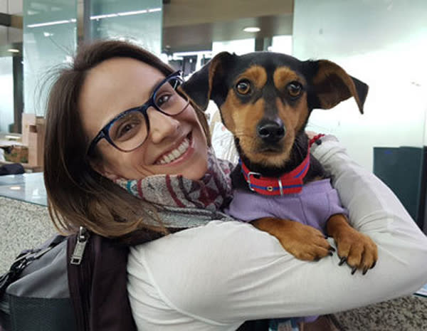 Canadian figure skater Meagan Duhamel poses with her dog she saved from the South Korean dog meat trade. (AP).