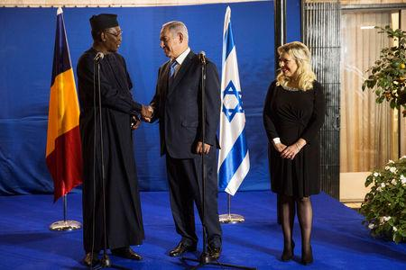 Chadian President Idriss Deby shakes hands with Israeli Prime Minister Benjamin Netanyahu as his wife Sara stands nearby, before their dinner at the Prime Minister's residence in Jerusalem, November 25, 2018. Heidi levine/Pool via REUTERS