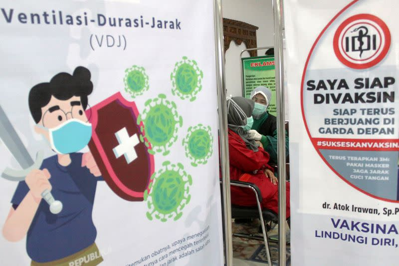 A medical worker receives her second dose of vaccine for the coronavirus disease (COVID-19) at a hospital in Sidoarjo