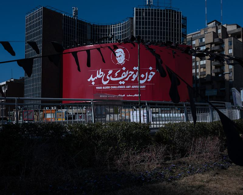 A massive banner showing Soleimani's likeness with the hashtag #HardRevenge hangs at Tehran's central Vali-e Asr Square. | Newsha Tavakolian—Magnum Photos for TIME