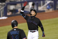 Miami Marlins' Isan Diaz reacts as he crosses the plate to score after hitting a grand slam during the third inning of a baseball game against the Miami Marlins, Friday, May 7, 2021, in Miami. (AP Photo/Lynne Sladky)