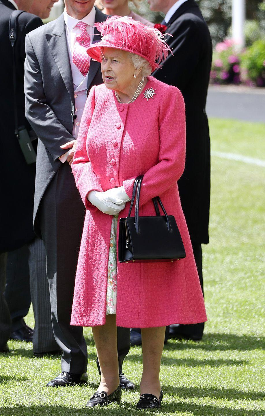<p>Here's a full-length look at the Queen's outfit today, the vibrant shade is a departure from the blue hues she chose earlier this week. </p>