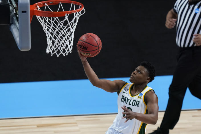 Baylor guard Moon Ursin drives to the basket during the second half of a college basketball game against Jackson State in the first round of the women's NCAA tournament at the Alamodome, Sunday, March 21, 2021, in San Antonio. (AP Photo/Eric Gay)
