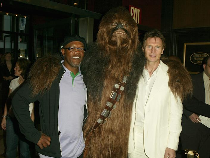 "Actors Samuel L. Jackson (left) and Liam Neeson pose with Chewbacca at the premiere of ""Star Wars: Episode III Revenge Of The Sith,"" at the Ziegfeld Theater on May 12, 2005 in New York City."