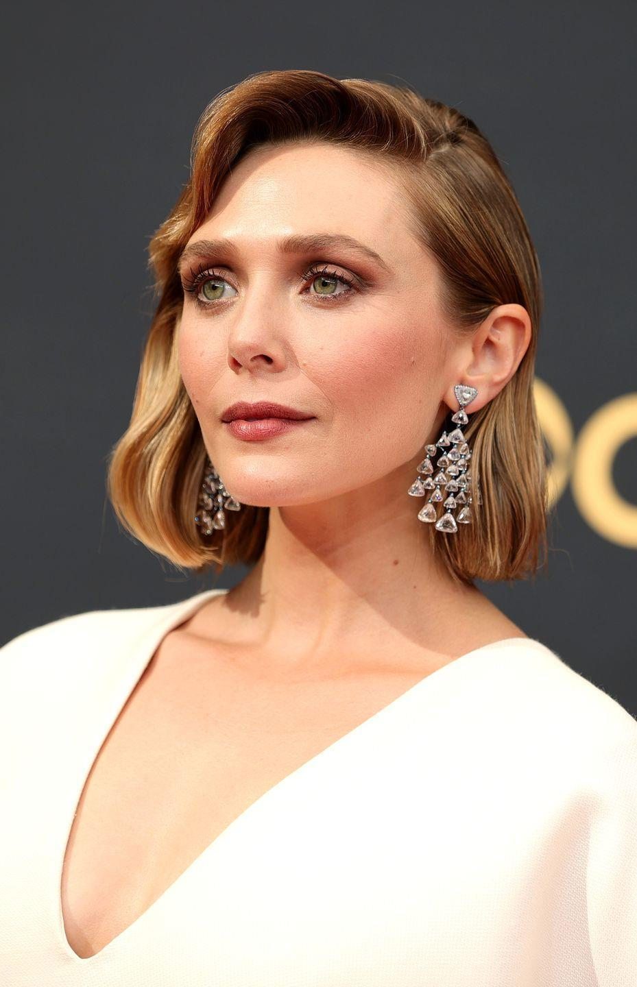 <p>A masterclass in modern Hollywood glamour, Elizabeth Olsen's hair by Adir Abergel was freshly cut into a bob and styled in crisp vintage waves. Her make-up, by artist Pati Dubroff, centred on muted neutrals, bringing an element of minimal Nineties style to the look. </p>
