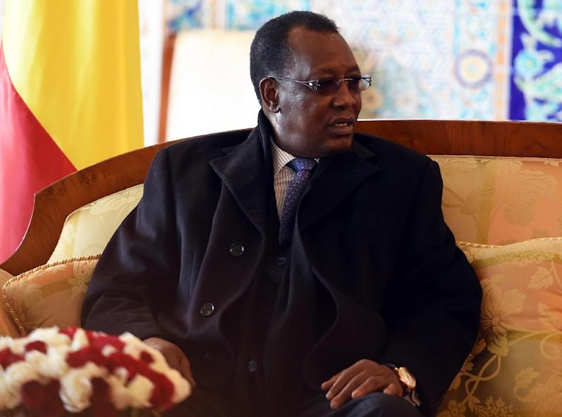 The President of Chad Idriss Deby Itno sits upon his arrival at Houari Boumediene Airport, outside Algiers, on December 27, 2014 (AFP Photo/Farouk Batiche)