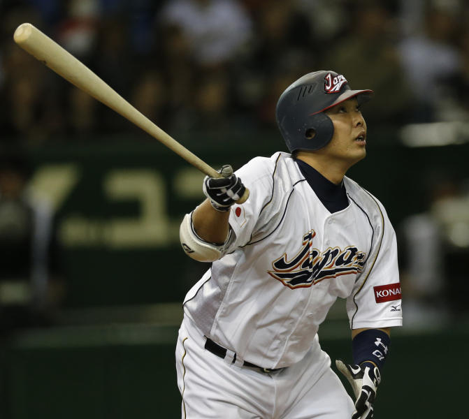 Japan's designated hitter Shinnosuke Abe hits a three-run homer off Netherlands' pitcher Jonatan Isenia in the second inning of their World Baseball Classic second round game at Tokyo Dome in Tokyo, Tuesday, March 12, 2013. (AP Photo/Koji Sasahara)