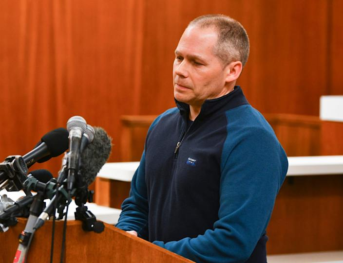 """Buffalo Police Chief Pat Budke pauses while speaking during a press conference regarding a shooting at the Allina Health Clinic Tuesday, Feb. 9, 2021, at the Wright County Government Center in Buffalo. """"Our heart breaks as a community,"""" Budke said."""
