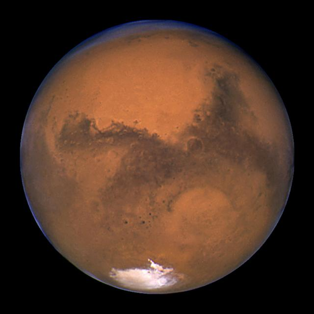 <p>NASA's Hubble Space Telescope took this snapshot of Mars 11 hours before the planet made its closest approach to Earth on Aug. 26, 2003. (Photo: J. Bell (Cornell U.) and M. Wolff (SSI)/NASA/Reuters) </p>
