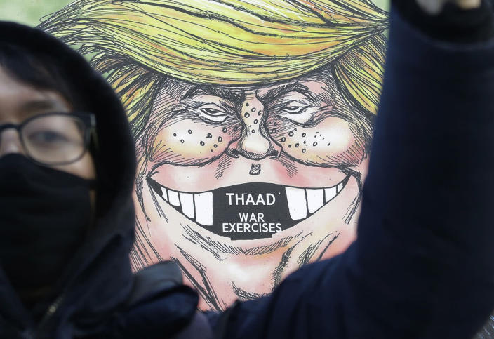 <p>A South Korean protester stands in front of a cartoon depicting U.S. President Donald Trump during a rally against U.S. Defense Secretary Jim Mattis' visit, in front of the government complex in Seoul, South Korea, Feb. 2, 2017. (Photo: Ahn Young-joon/AP) </p>