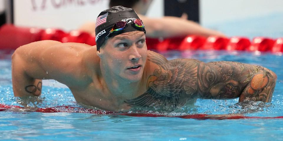 Caeleb Dressel hangs on the lane lines and looks up at the Tokyo Olympics.