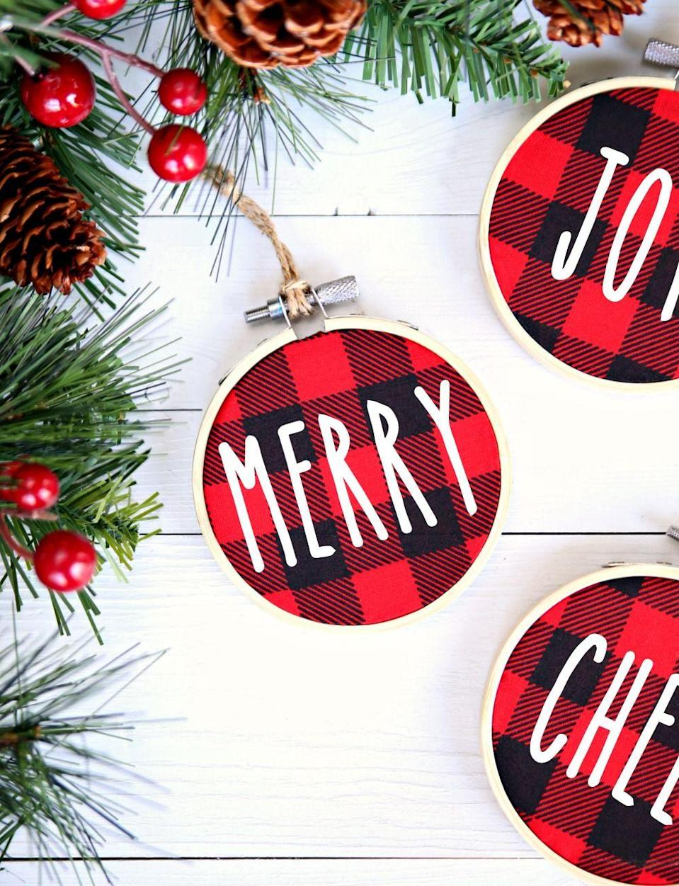 """<p>If perfection is your goal, use a cutting machine and iron-on vinyl to make these graphic ornaments. But if speed is your goal, letter stickers work, too. </p><p><em>Get the tutorial at <a href=""""https://www.happygoluckyblog.com/buffalo-check-christmas-ornaments/"""" rel=""""nofollow noopener"""" target=""""_blank"""" data-ylk=""""slk:Happy Go Lucky Blog"""" class=""""link rapid-noclick-resp"""">Happy Go Lucky Blog</a>. </em></p><p><a class=""""link rapid-noclick-resp"""" href=""""https://www.amazon.com/Cricut-Joy-Machine-Portable-Personalized/dp/B084LMTR98?tag=syn-yahoo-20&ascsubtag=%5Bartid%7C10072.g.34443405%5Bsrc%7Cyahoo-us"""" rel=""""nofollow noopener"""" target=""""_blank"""" data-ylk=""""slk:SHOP CRICUT"""">SHOP CRICUT</a></p>"""