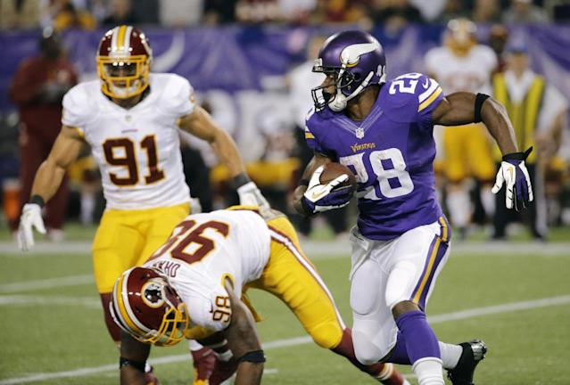 Minnesota Vikings running back Adrian Peterson, right, runs from Washington Redskins outside linebacker Brian Orakpo and outside linebacker Ryan Kerrigan (91) during the first half of an NFL football game Thursday, Nov. 7, 2013, in Minneapolis. (AP Photo/Ann Heisenfelt)