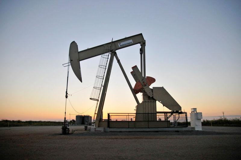 FILE PHOTO - A pump jack operates at a well site leased by Devon Energy Production Company near Guthrie, Oklahoma