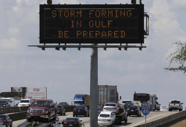 <p>Motorists in Houston pass a sign warning of Hurricane Harvey as the storm intensifies in the Gulf of Mexico, Thursday, Aug. 24, 2017. (Photo: David J. Phillip/AP) </p>