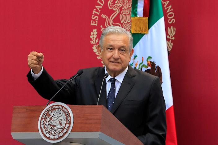 FILE PHOTO: Mexico's President Andres Manuel Lopez Obrador greets the Mexican delegation competing at the 2019 Pan American Games Lima, in Mexico City, Mexico, July 15, 2019. REUTERS/Carlos Jasso/File Photo