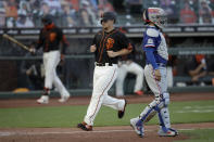 San Francisco Giants' Alex Dickerson, center, scores past Texas Rangers catcher Robinson Chirinos during the third inning of a baseball game Saturday, Aug. 1, 2020, in San Francisco. Dickerson scored on a two-run single by Donovan Solano. (AP Photo/Ben Margot)
