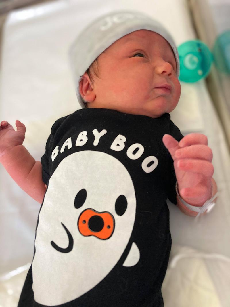 Jonesy is pictured wearing a Halloween-themed onesie reading 'baby boo'. Source: Supplied