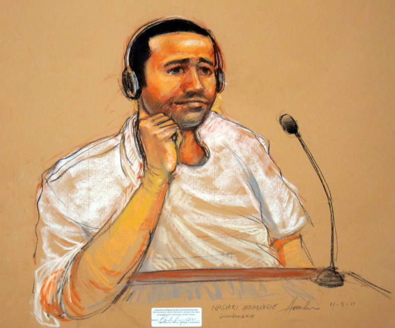 In this sketch by courtroom artist Janet Hamlin, taken Nov. 9, 2011, reviewed by the U.S. military, Abd al-Rahim al-Nashiri is seen during his military commissions arraignment at the Guantanamo Bay detention center in Guantanamo, Cuba. A judge at Guantanamo Bay refused Monday to suspend a pretrial hearing for Abd al-Rahim al-Nashiri, the prisoner accused of orchestrating the attack on the USS Cole, ruling that defense lawyers had offered no evidence supporting their suspicion that the CIA can eavesdrop on their private conversations with their client.   (AP Photo/Janet Hamlin, Pool)