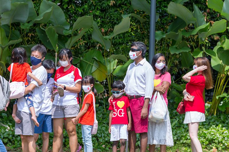 People waiting outside the Ng Teng Fong General Hospital on Sunday (9 August) morning to catch the National Day Parade 2020 mobile column passing by. (PHOTO: Dhany Osman / Yahoo News Singapore)