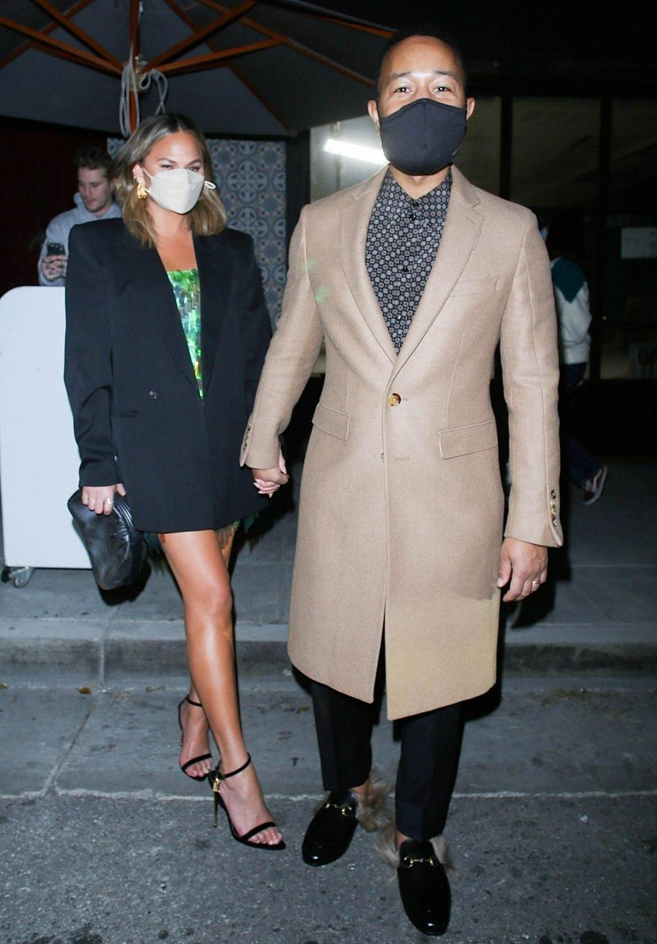 <p>Chrissy Teigen and John Legend get all dolled up for a romantic date night at Sapgos Restaurant late Sunday night in L.A.</p>