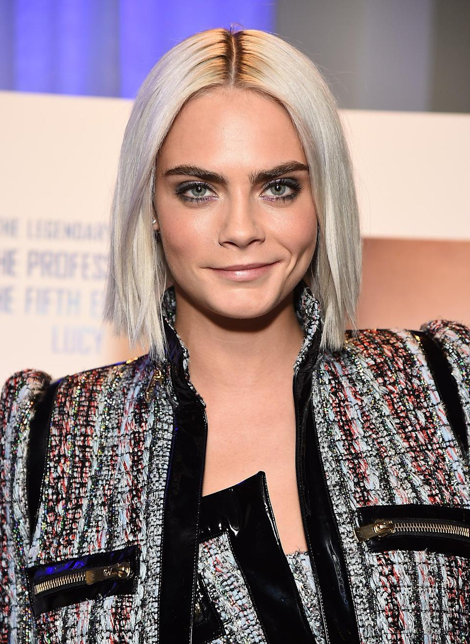 <p>Delevingne switched things up with a middle part and superstraight hair, a style that showed off her blunt cut beautifully. </p>