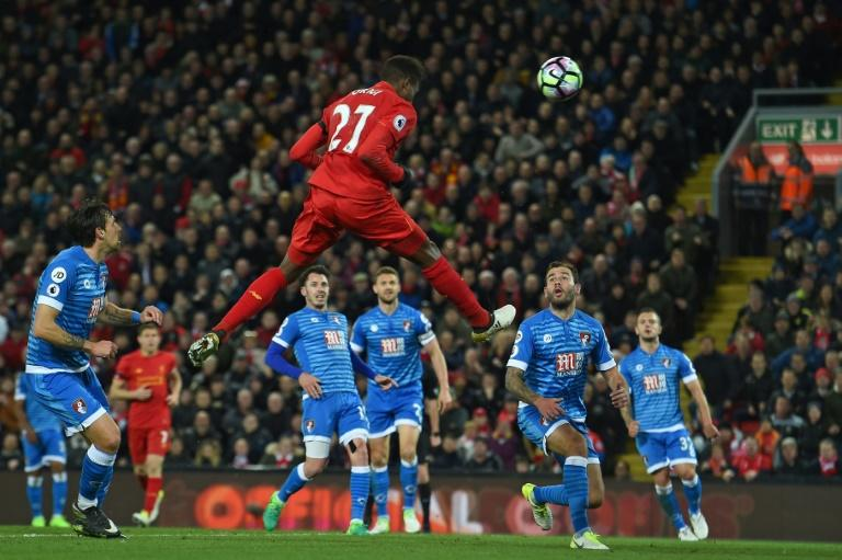 Liverpool's striker Divock Origi jumps to head their second goal during the English Premier League football match between Liverpool and Bournemouth at Anfield in Liverpool, north west England on April 5, 2017