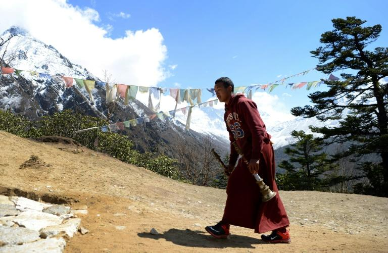 Monks in flowing maroon robes had decorated the site where Swiss climber Ueli Steck was cremated, using multicoloured Buddhist prayer flags and offered prayers and music as the funeral pyre was lit