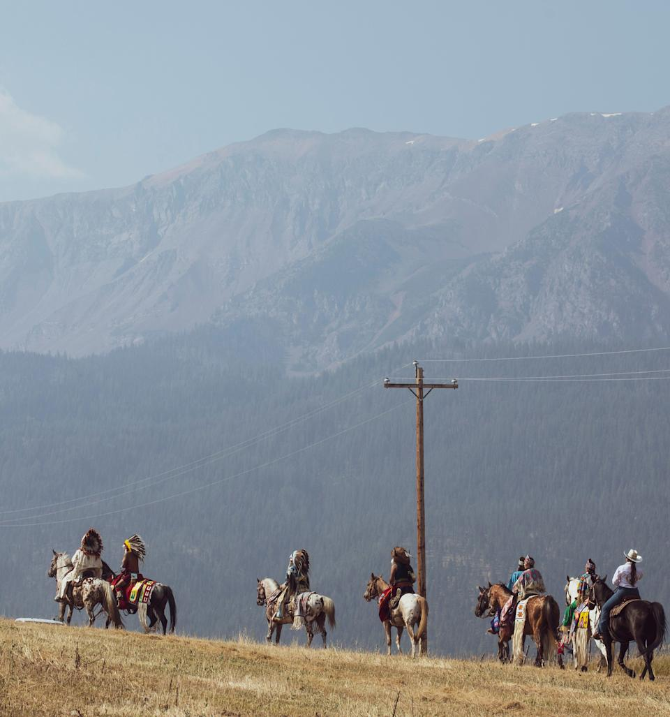 """Members of the Nez Perce Tribe ride to Am'sáaxpa or """"the place of boulders,"""" for a land blessing ceremony on Thursday, July 29, 2021 in Joseph, Ore. The tribe purchased 148 acres of ancestral land in December 2020, over a century after being forced out of the area."""